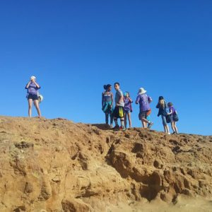 Guided group hiking to the top of the rock at Ánimo Ellen Ochoa Charter Middle School | arc Adventure