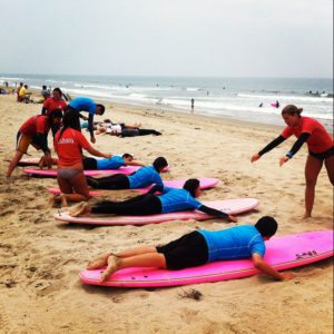 Surf lesson in Hawaii for youth groups through arc Adventure.